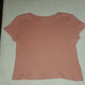 A cropped pink American Eagle top
